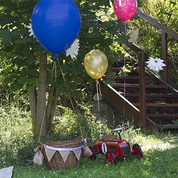 Szülinap kutyákkal, arannyal és hőlégballonnal